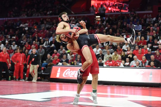 Rutgers University freshman JoJo Aragona, shown being lifted by Cornell's Noah Baughman on Jan. 17, recorded a dramatic win against Rider Sunday night.
