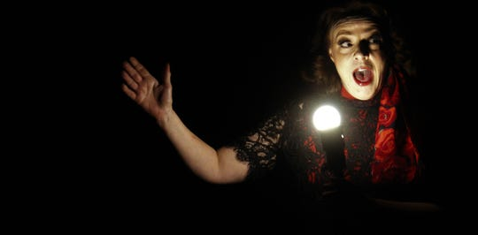 """Puck (Elise-Pryor-Harden) presents eerily in the ghost light of the theater she haunts in this rehearsal scene from """"Midsummer,"""" ACT's  current production."""
