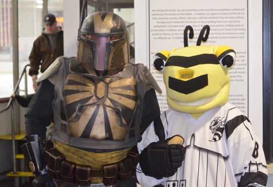 Battle Creek mascot B.B. Sting, with his special Star Wars jersey, poses with a Star Wars character at the Rumble Bees 'Star Wars Night' on Saturday.