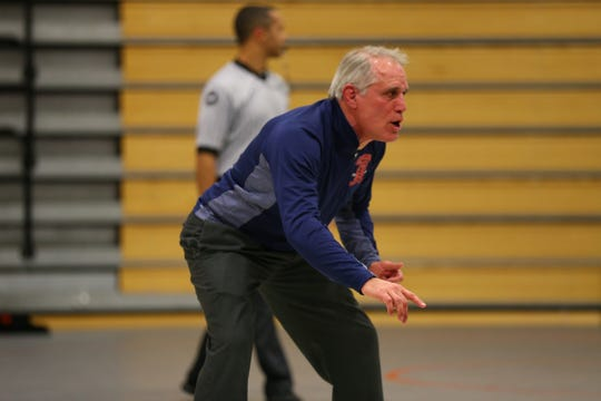 Chenango Forks coach Rick Gumble reacts during a match at the Southern Tier Athletic Conference Championships at Johnson City.