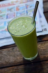 A green smoothie with frozen peaches is one way to take advantage of summer's bounty in the winter.