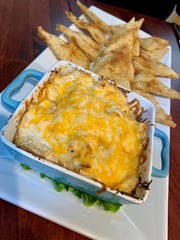 Maryland Crab Dip at Grey Belly's came served on a long plate with warm, seasoned pita chips. It contains blue fin crab, five cheeses and house seasoning, all topped with cheese and broiled, and is reminiscent of that retro favorite, Crab Imperial.