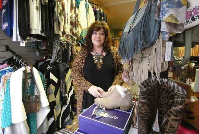 Ally Suter stands in the new Without Borders Boutique in downtown Bucyrus.
