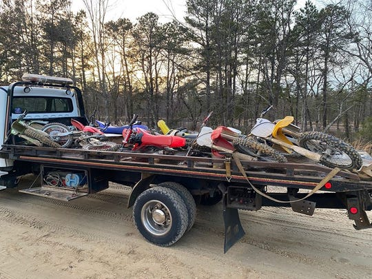 Bikes are loaded on a trailer at the Winslow Wildlife Management Area. Police say riders called damage during a huge party.