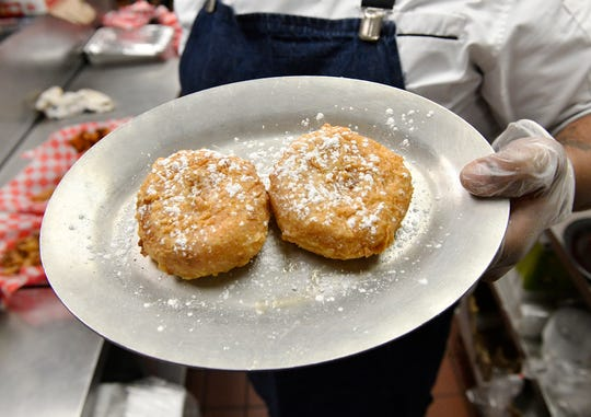 Willingboro native Timothy Witcher prepares an order of buttermilk-fried doughnuts at his Turnersville restaurant, The Wing Kitchen.