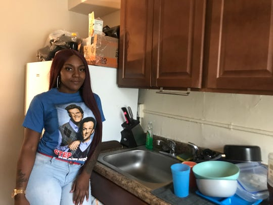 Carranna Freeman stands in the kitchen of her unit at Crestbury Apartments. Freeman won't use the water for any reason after raw sewage backed up into her sink and bathtub over the weekend.