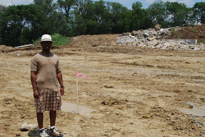 Bishop Victor Couzens stands in 2008 where the new Inspirational Baptist Church was soon to be constructed. The project, which was is estimated to cost $9 million, was completed in 2009.