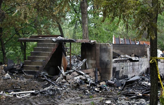 Charred rubble and concrete from a home in Franklin, Ohio, remained an explosion June 2, 2010. Three bodies were found in the rubble. Investigators said that a methamphetamine lab was to blame.