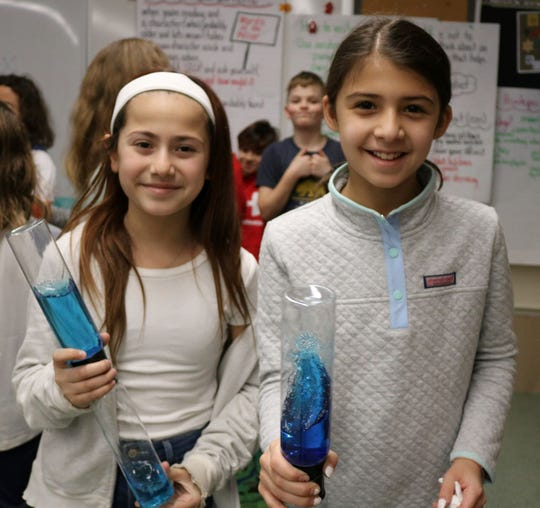 Tamaques fifth-graders Michela Hurley, left, and Shylah Verma enjoy creating spiraling vortexes during STEAM Day at Tamaques on Jan. 24.