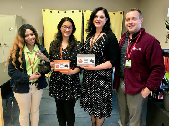 Representatives of Turtle Back Zoo and the Zoological Society of New Jersey accepting a donation from Linden High School zoology students to help animals hurt by the Australian wildfires. (Left to right) Zoo educator Shatiaa Burwell holding a burrowing owl; LHS zoology teacher Amanda Montealegre; LHS science teacher and science department chairperson Kelly Gallagher; and Adam Kerins, executive director of the Zoological Society and a zookeeper at the Turtleback Zoo.