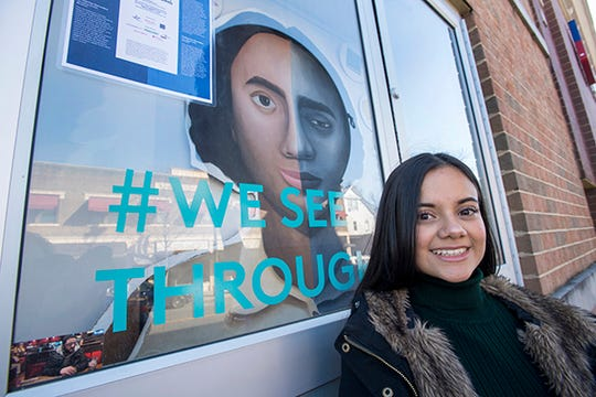 """Kat Gonzalez, a senior at Mason Gross School of the Arts, was one of 10 students and alumni from Rutgers who volunteered to champion social justice issues for the third annual """"Windows of Understanding"""" public art project."""