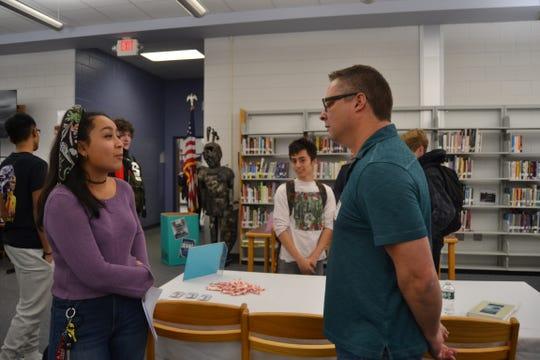 Sydney Maisonet, an Old Bridge High School (OBHS) senior, discusses career options with Joseph Kelly, a ceramic engineer.