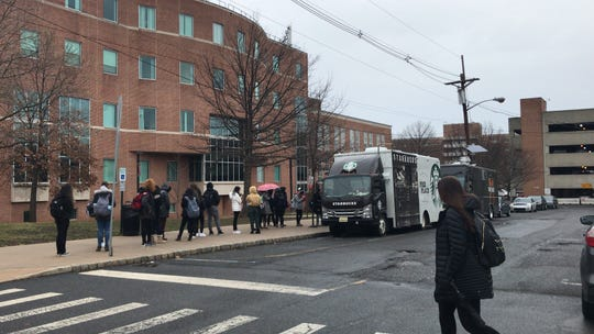 Rutgers students stand on long lines to use their meal-plan swipes at the Starbucks and new Three Chilies food trucks.