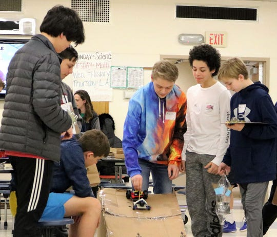The Science Olympiad on Jan. 28 had students from Edison and Roosevelt Intermediate Schools teaming up and competing in a number of design challenges, including designing, building, and testing a small vehicle.