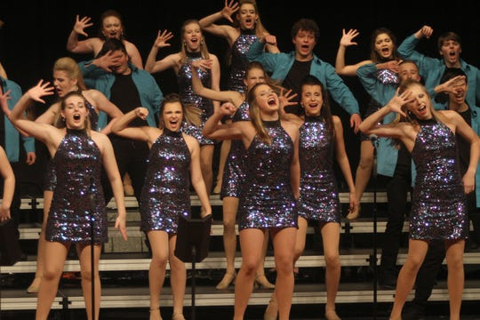 The Dallas Center-Grimes Momentum show choir performs during the Norwalk Nexus show choir competition on Feb. 8. Momentum was one of six finalists in the competition.