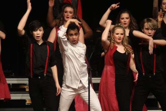 The Des Moines Roosevelt Revelation show choir performs during the Norwalk Nexus show choir competition on Feb. 8. Revelation was one of six finalists in the competition.