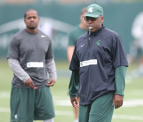Michigan State co-defensive coordinator Harlon Barnett watches defensive drills during practice Aug. 8, 2015 in East Lansing.