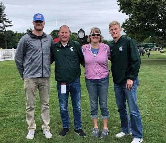 Mike Mokma, left, his brother, Chris, right, and their parents, Scott and Jennifer.