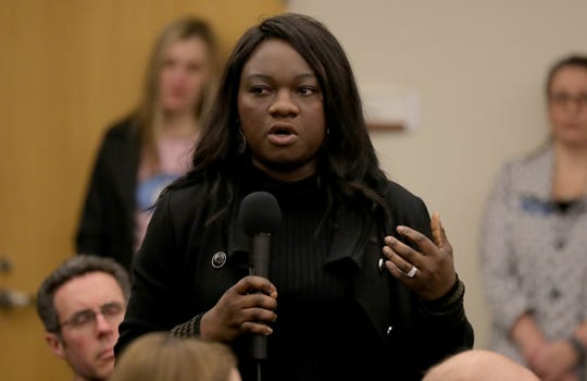 Aramide Pinheiro-Boatswain talks about her children's experiences in the school system during a gathering Sunday to discuss racial diversity in Saline.