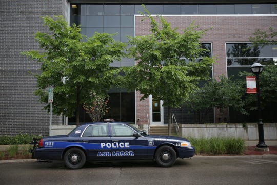 An Ann Arbor police vehicle sits out in front of the police station in Ann Arbor, Mich. photographed on Wednesday, Aug. 17, 2016.
