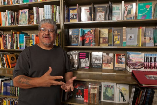 """Activist Luis J. Rodriguez poses for a photo at his independent bookstore and community center """"Tia Chucha"""" in Los Angeles in 2011."""
