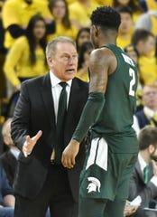 Michigan State coach Tom Izzo talks with Michigan State guard Rocket Watts in the second half at Michigan on Saturday.