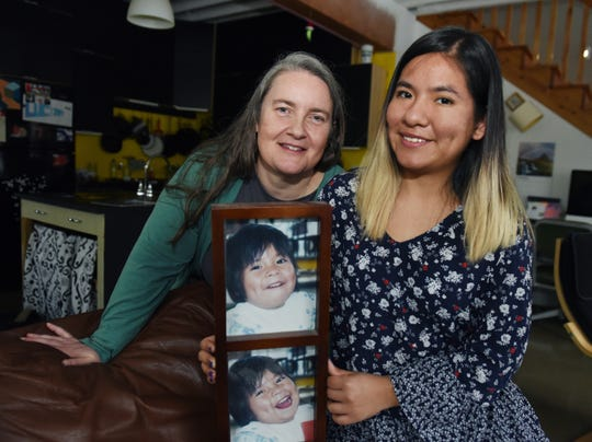 21-year-old Daniela Sander, right, hold a photo from when she was 3 with her adoptive mother, Katie Sander.