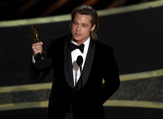 "Brad Pitt accepts the award for best performance by an actor in a supporting role for ""Once Upon a Time in Hollywood"" at the Oscars on Sunday, Feb. 9, 2020, at the Dolby Theatre in Los Angeles."