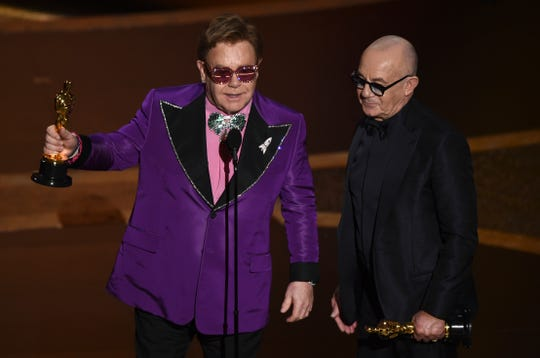 "Elton John, left, and Bernie Taupin accept the award for best original song for ""(I'm Gonna) Love Me Again"" from ""Rocketman"" at the Oscars on Sunday, Feb. 9, 2020, at the Dolby Theatre in Los Angeles."