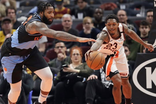 Cleveland Cavaliers' Andre Drummond, left, and Los Angeles Clippers' Lou Williams battle for loose ball in the second half.