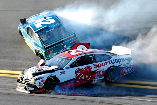 Erik Jones (20) and Kyle Larson (42) wreck going through Turn 4 during the NASCAR Busch Clash auto race Sunday at Daytona International Speedway.