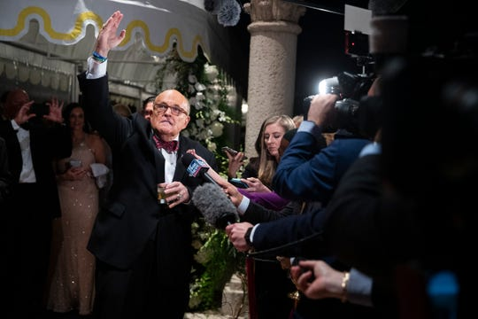 Former New York Mayor Rudy Giuliani, an attorney for President Donald Trump, speaks to reporters as he arrives for a New Year's Eve party hosted by President Donald Trump at his Mar-a-Lago property, Tuesday, Dec. 31, 2019, in Palm Beach, Fla.