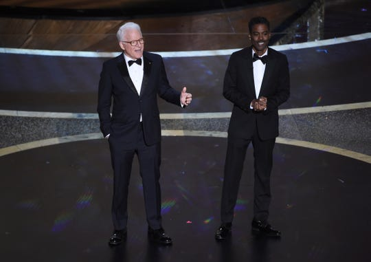 Steve Martin, left, and Chris Rock speak onstage at the Oscars on Sunday, Feb. 9, 2020, at the Dolby Theatre in Los Angeles.