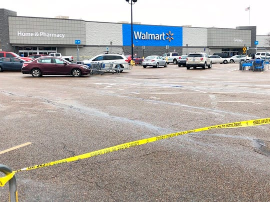 Police tape blocks off a Walmart store parking lot in Forrest City, Ark., on Monday, Feb. 10, 2020. Police say at least three people, including two officers, have been shot this Walmart in eastern Arkansas.