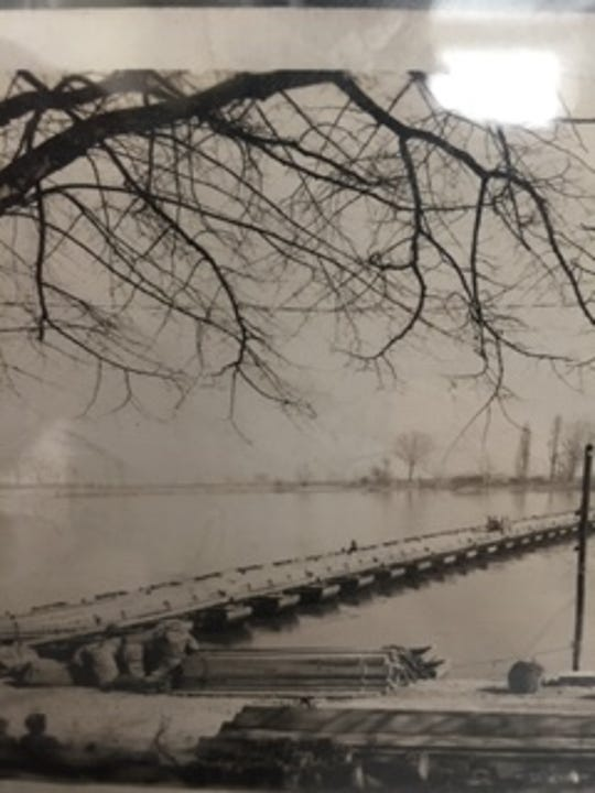 A photo of a bridge into the Rhine.