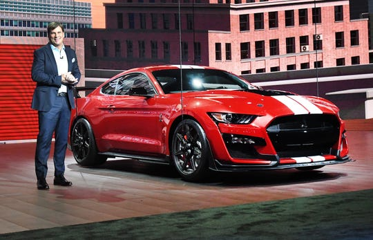 Ford Motor Co.'s new chief operating officer, Jim Farley, introduces the Mustang GT500 at the Detroit auto show in January 2019.