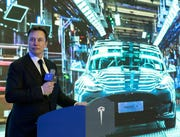 Tesla CEO Elon Musk speaks at a delivery ceremony for the first Tesla Model 3 cars made at Tesla's Shanghai factory in Shanghai, Tuesday, Jan. 7, 2020.