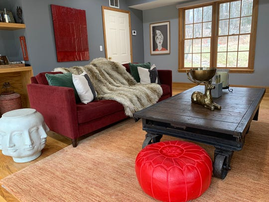 A blend of dark ruby red, forest green, dark brown and charcoal walls feels warm, rich and cozy.