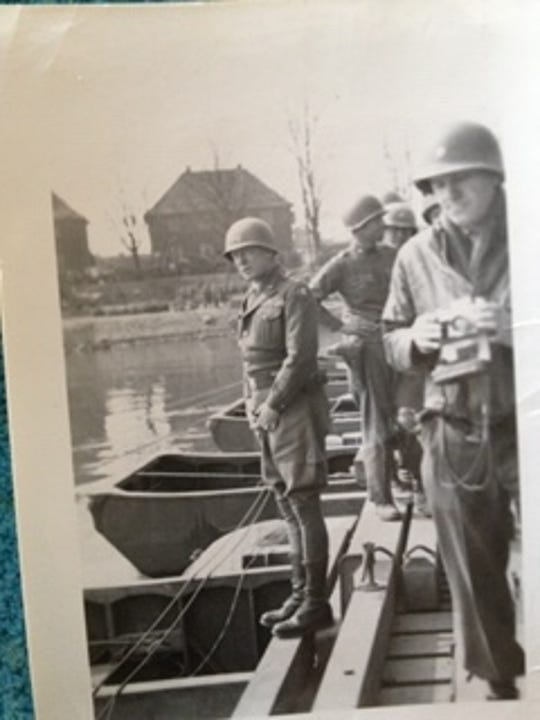 A photo of U.S. General Patton on a bridge into the Rhine which Venuto carries in his wallet today in memory of his father, who helped in its construction.