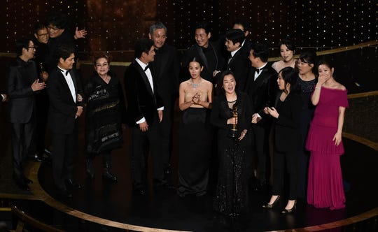 "The cast and crew of ""Parasite"" accept the award for best picture at the Oscars on Sunday, Feb. 9, 2020, at the Dolby Theatre in Los Angeles."