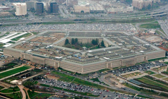 "This March 27, 2008, aerial file photo, shows the Pentagon in Washington. Amazon is protesting the Pentagon's decision to award a huge cloud-computing contract to Microsoft, citing ""unmistakable bias"" in the decision. Amazon's competitive bid for the ""war cloud"" drew criticism from President Donald Trump and its business rivals."