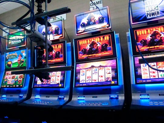 This Feb. 10, 2020 photo shows slot machines in a secure room at the Hard Rock casino in Atlantic City N.J. that have been connected to the internet as part of a new product offering. The technology lets people use the internet to gamble on real-life slot machines that are inside the casino.