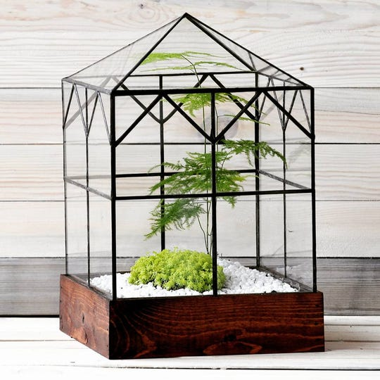 LeadHead Glass, co-owned by Chad Ackley and Derek Smiertka, makes terrariums from reclaimed wood and glass.