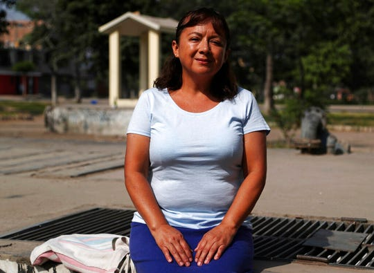 In this Feb. 6, 2020, photo, Peruvian Margarita Del Pilar Fitzpatrick, poses for a portrait at San Martin de Porres neighborhood in Lima, Peru. The day Fitzpatrick applied for an Illinois driver's license upended her life. When a clerk offered to register her to vote, the Peruvian citizen mistakenly accepted, leading to long legal battles and eventually deportation.