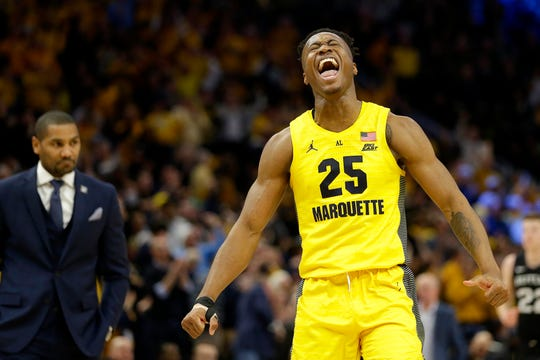 Marquette's Koby McEwen (25) reacts during the second half Sunday against Butler.