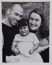 4-year-old Daniela Sander, center, with her adoptive parents Jeff and Katie Sander in this 2003 photo.