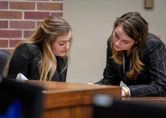 Castle High School's Lydia Walker reads a document as she is questioned on the witness stand by Mater Dei's Andrea Reisinger, as the attorney, during a Mock Trial Competition hosted by the Evansville Bar Association and the Indiana Bar Foundation Saturday at the Vanderburgh County Courthouse, February 8, 2020.