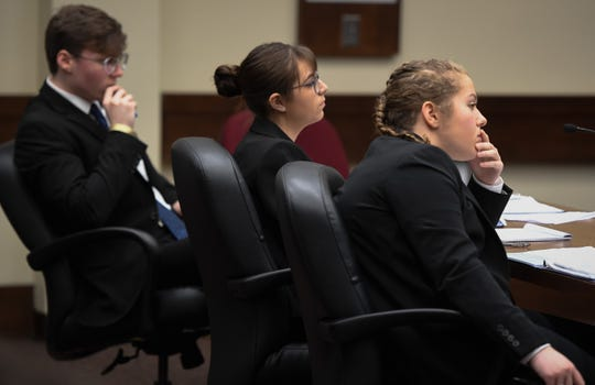 The Castle defense team, left to right, Zane Phelps, Chloe Hensley and Sydney Walther listen to testimony during a Mock Trial Competition hosted by the Evansville Bar Association and the Indiana Bar Foundation Saturday at the Vanderburgh County Courthouse, February 8, 2020.