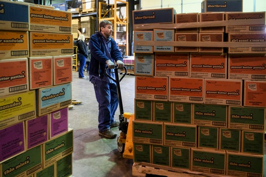 Brian Market moves a pallet of Girl Scout Cookies to the loading dock as troop leaders and volunteers arrive to pick up their cookie pre-orders at Belmont Moving & Storage in Evansville, Ind., Monday, Feb. 10, 2020. Cookie sales will continue through March 8.