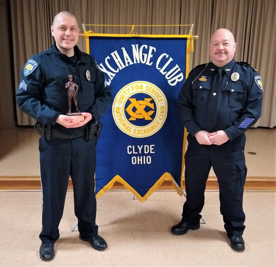 Clyde Police Sergeant Bruce Kardotzke, left, is awarded the Police Office of the Year. Clyde Police Chief Monti Campbell, right, also attended the annual dinner hosted by the Clyde Exchange Club.